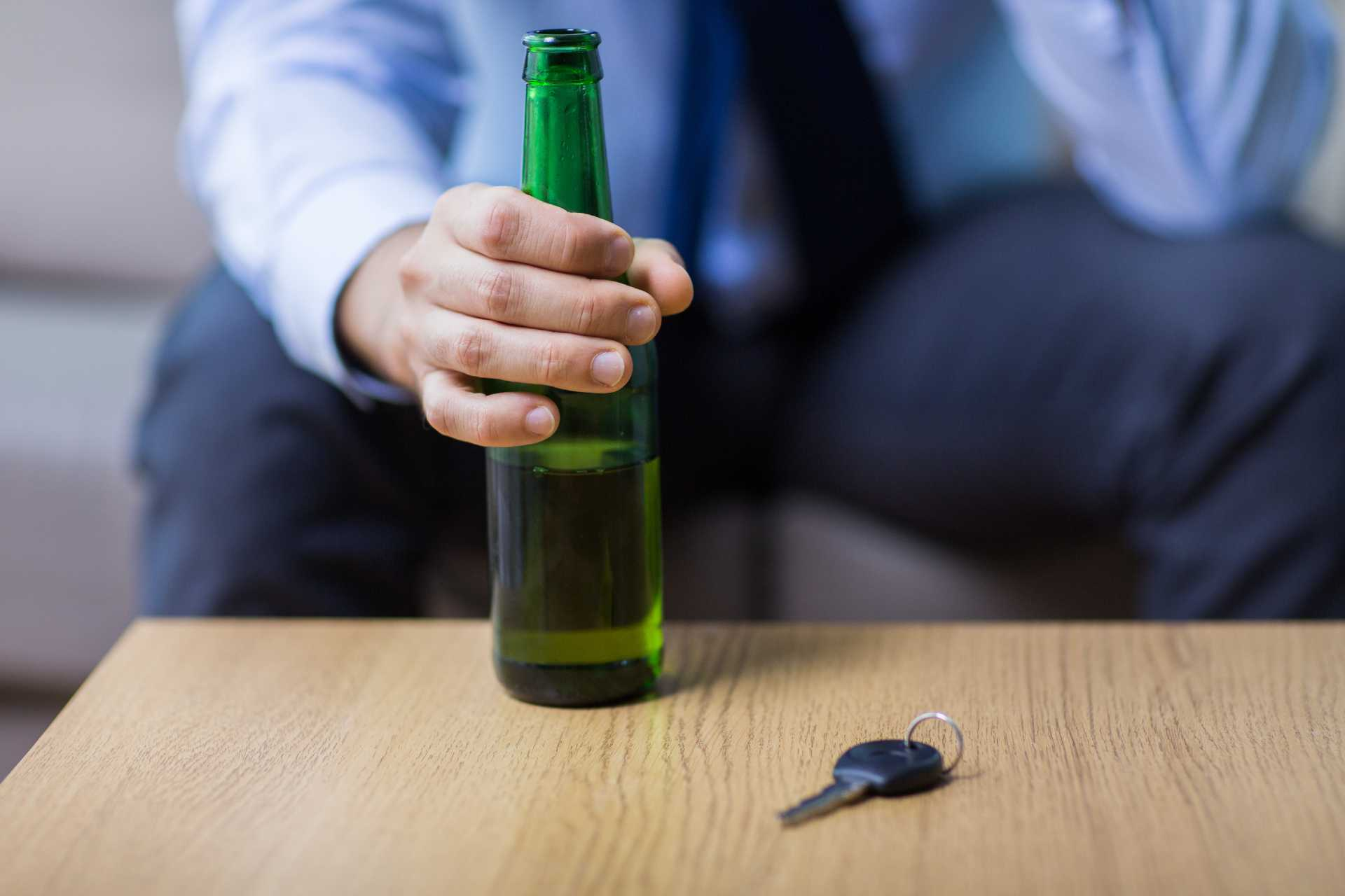 Man drinking before driving
